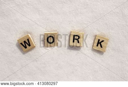 Work Word On A White Clean Snow. Work Phrase Is Written On A Snow With Wooden Letters.