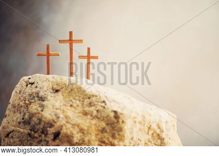 Silhouette Of Three Crosses On Calvary Hill, Grey Background. Crucifixion, Resurrection Of Jesus Chr