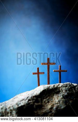 Three Wooden Cross On Calvary Hill, Blue Background. Crucifixion, Resurrection Of Jesus Christ. Chri