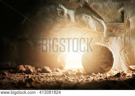 Empty Tomb Of Jesus Christ With Light. Born To Die, Born To Rise. He Is Not Here He Is Risen . Savio