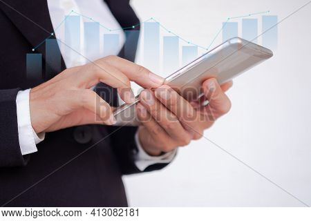 Hand Staff Business Woman With Black Suit Using Mobile Or Smart Phone With Graph Stock Market. Plani