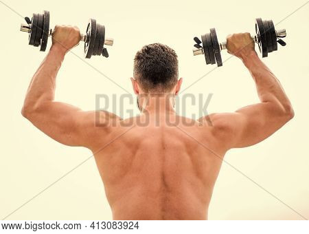 Muscular Back Man Exercising In Morning With Barbell. Fitness And Sport Equipment. Man Sportsman Wei