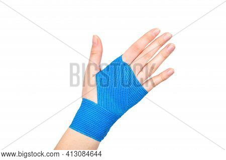 Blue Elastic Bandage On The Wrist On A White Background, Isolate. Concept For Fixation Of The Wrist