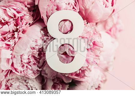 8 March. Happy Womens Day. Creative Layout. Pink Peony Flowers And Digit Eight 8. Birthday Greeting