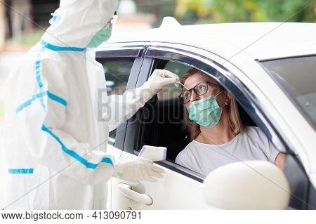 Coronavirus Nasal Drive-through Swab Test. Doctor In Hazmat Suit Taking Saliva Sample For Covid-19 D