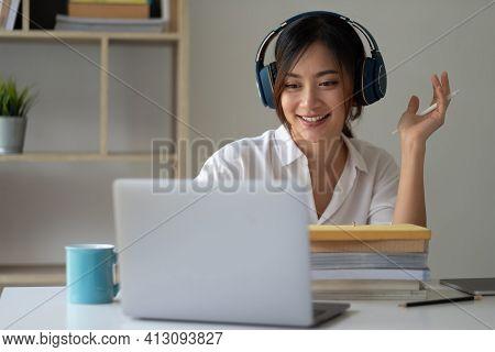 Asian Woman Wearing Headphones Study Online Watching Webinar Podcast On Laptop Listening Learning Ed