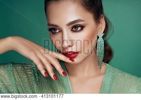 Portrait Beautiful Woman With Jewelry. Brunette Girl With Long Smooth Hair. Beauty Fashion. Model Gi
