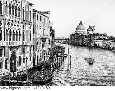 Black and white View of the Grand Canal and Basilica Santa Maria della Salute from the Ponte dell'Accademia in Venice, Italy