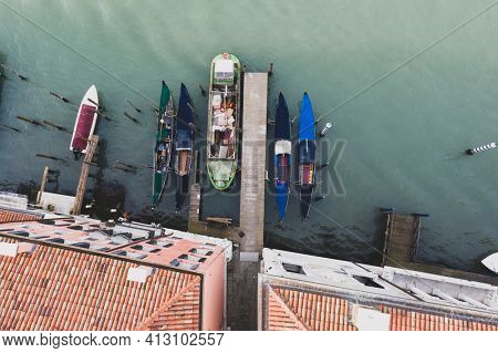 Top view on a gondolas and boats docking, Venice, Italy