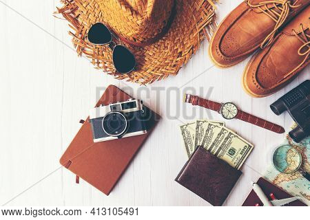 Top View Of Traveler Accessories Items Man And Camera With Tourism Backpack Visiting For Planning Tr