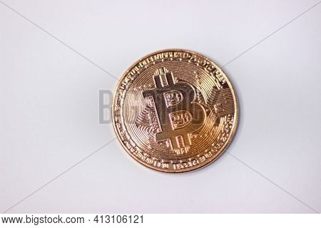 Physical Bitcoin Coin. Bitcoin On White Background. Bitcoin Cryptocurrency On White Canvas.