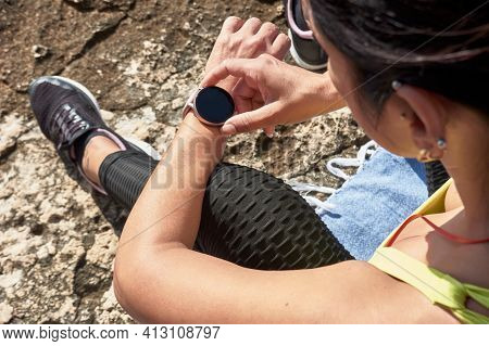 Latin Woman, Middle-aged, Resting, Regaining Strength, Eating, Drinking Water, After A Gym Session,