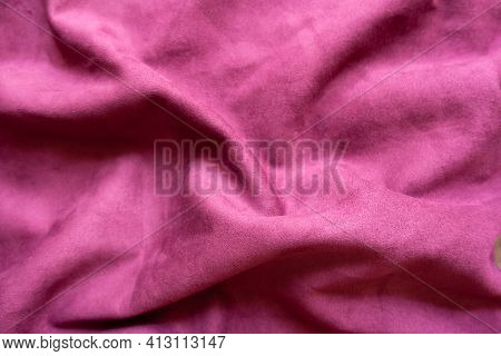 Draped Cerise Colored Faux Suede Fabric From Above
