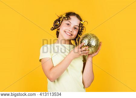 Retro Party. Cheerful Girl With Disco Ball. Fashion Kid Posing With Curlers In Hair. Fancy Teen. Hai
