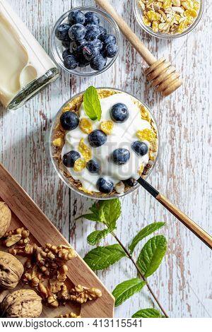 Delicious Dessert Of Blueberries, Yogurt And Cereals (muesli). Refreshing And Healthy Breakfast Of Y