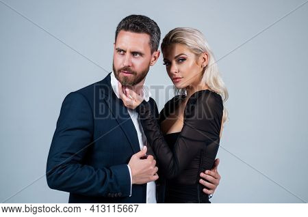 Formal Couple In Love. Businessman And Sexy Lady Embrace. Woman With Handsome Man. Love And Romance.