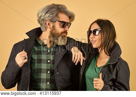 Outdoor Autumn Outfit. Stylish Couple Of Models In Autumn Outfits Posing. Fashion Couple In Love. En