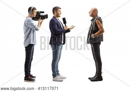 TV reporter and a cameraman interviewing a bald punk rocker isolated on white background