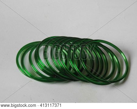 Group Of Green Color Ladies Traditional Glass Bangles Isolated On White Background