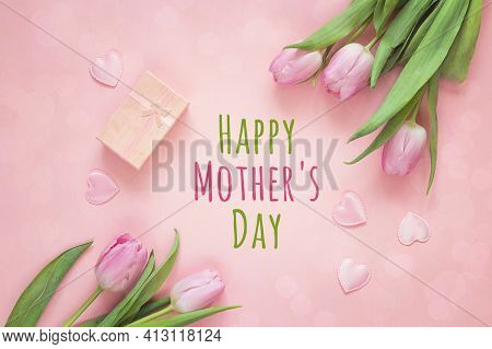 Mothers Day Background With Pink Tulips, Hearts And Gift Box On Pink Background. Top View. Happy Mot