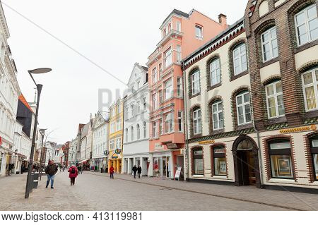 Flensburg, Germany - February 9, 2017: Ordinary People Walk The Grosse Strasse On A Daytime, It Is A
