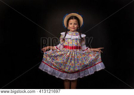 Festa Junina In Brazil, Brazilian Girl With Braids And Dressed For Junina Party With Straw Hat Doing