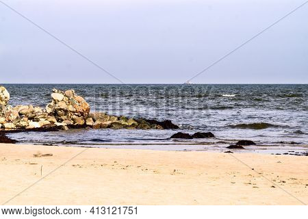 Large Stone Boulders Of The Breakwater On The Shore Of The Gulf Of Riga At Cape Kolka On A Summer Da