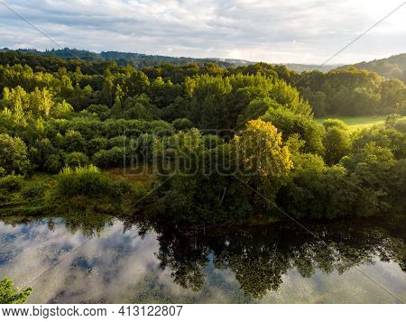 Beautiful Aerial Forest Scene In Summer. Green Trees And River On Summer Day. City Park Scenery In V