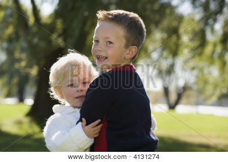 Young Brothers Holding Each Other