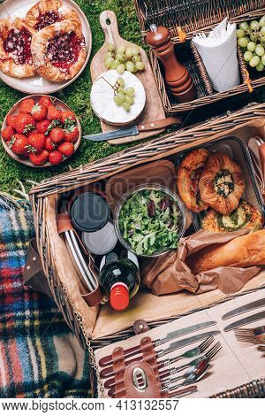 Great Picnic Basket With Cheese, Strawberries, Grapes, Baguette, Pizza, Salad, Wine For Picnic On Pl