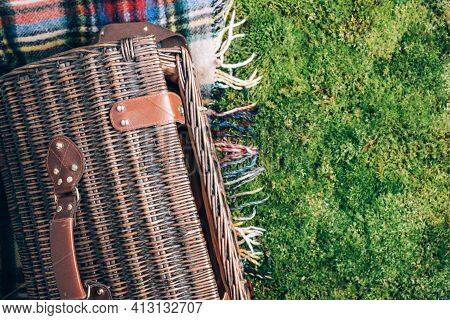 Summer Picnic Straw Basket On Green Grass Background. Top View. Copy Space. Summer Picnic Time. Bann