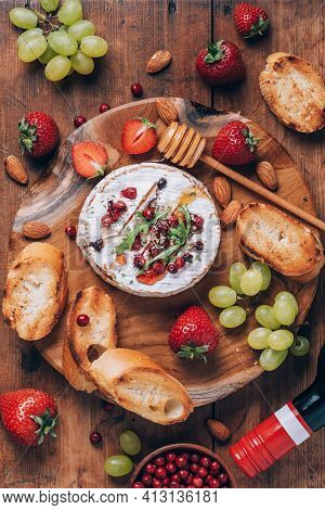 Romantic Date Night. Valentine's Day, Love Concept. Baked Camembert Cheese With Honey, Rucola, Cranb