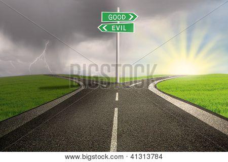 Road Sign Of Good Vs Evil