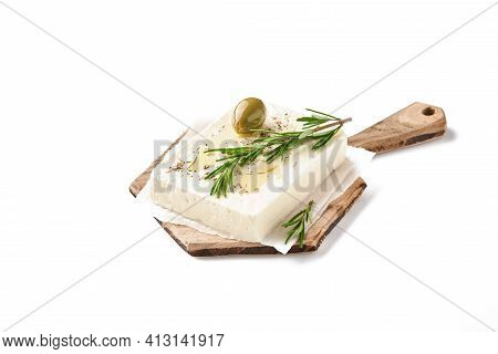 Cheese Feta With Rosemary, Herbs And Olive Oil On Wooden Cutting Board Isolated On White Background.