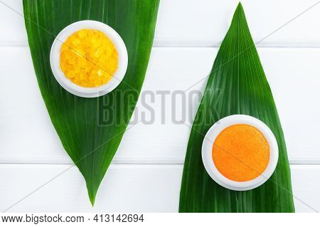 Natural Organic Cosmetics: Orange Scrub And Sea Salt On White Wooden Background With Green Leaves. S