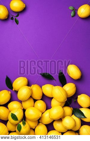 Lemons Frame On Violet Background. Immune System Booster. Copy Space. Top View. Flat Lay. Citrus Fru