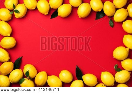 Lemons Frame On Red Background. Immune System Booster. Copy Space. Top View. Flat Lay. Citrus Fruits