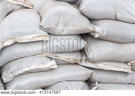 Wall Of Sandbags For Flood Defense Or Military Use Close Up. Heap Of Sacks