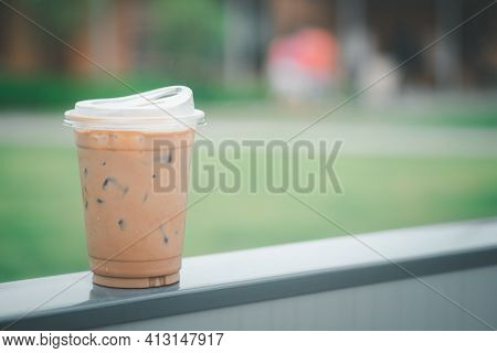 Iced Coffee Mocha In Plastic Glass With New Lid Design For Don't Use Drink Straw. Concept Of Reduce
