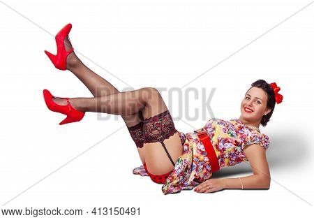 Young Beautiful Woman Posing While Lying On The Floor In Studio On White Background. Pinup Style
