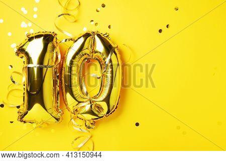 Gold Foil Balloon Number, Digit Ten. Birthday Greeting Card, Inscription 10. Anniversary Celebration