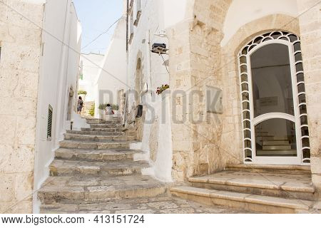 Old Town Of Ostuni During A Sunny Day, The White Village. It Is A Turistic Destination In Puglia In