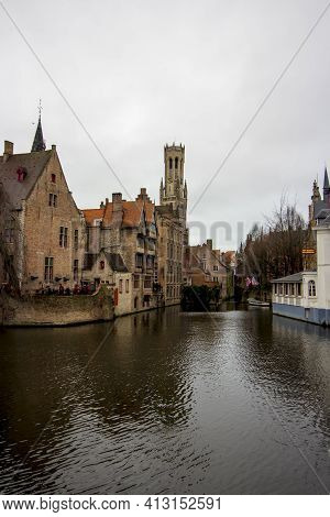 Bruges ( Bruxelles), Belgium - 02 10 2019: Panoramic View Of Medieval Houses On The River In Bruges.