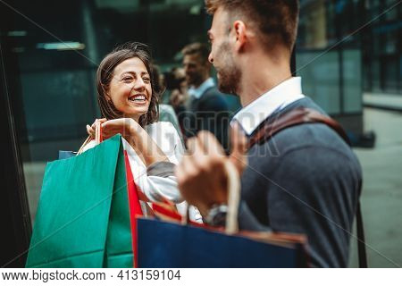 Sale, Travel Love Consumerism And People Concept. Happy Couple With Shopping Bags In The City