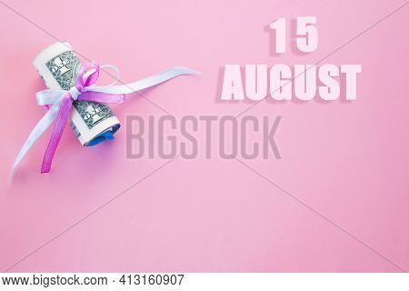 Calendar Date On Pink Background With Rolled Up Dollar Bills Pinned By Pink And Blue Ribbon With Cop