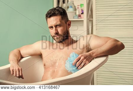 Wash Off Foam With Water Carefully. Man Wash Muscular Body With Foam Sponge. Macho Naked In Bathtub.