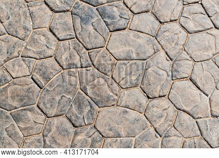 The Texture Of The Mosaic Sidewalk. The Texture Of The Sidewalk Folded From Artificial Paving Stones