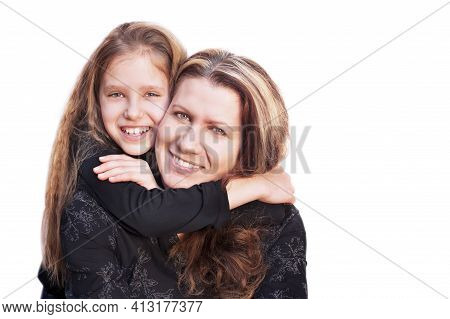 Young Girl Hugs Her Mother On A White Background After A Long Quarrel. They Are Both Happy That They
