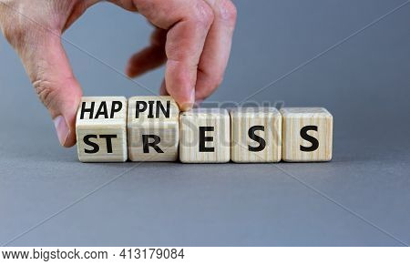 Happiness Instead Of Stress. Businessman Turns A Cube And Changes The Word 'stress' To 'happiness'.