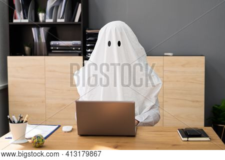Ghostwriter In Office. Creative Ghost Writer Using Computer